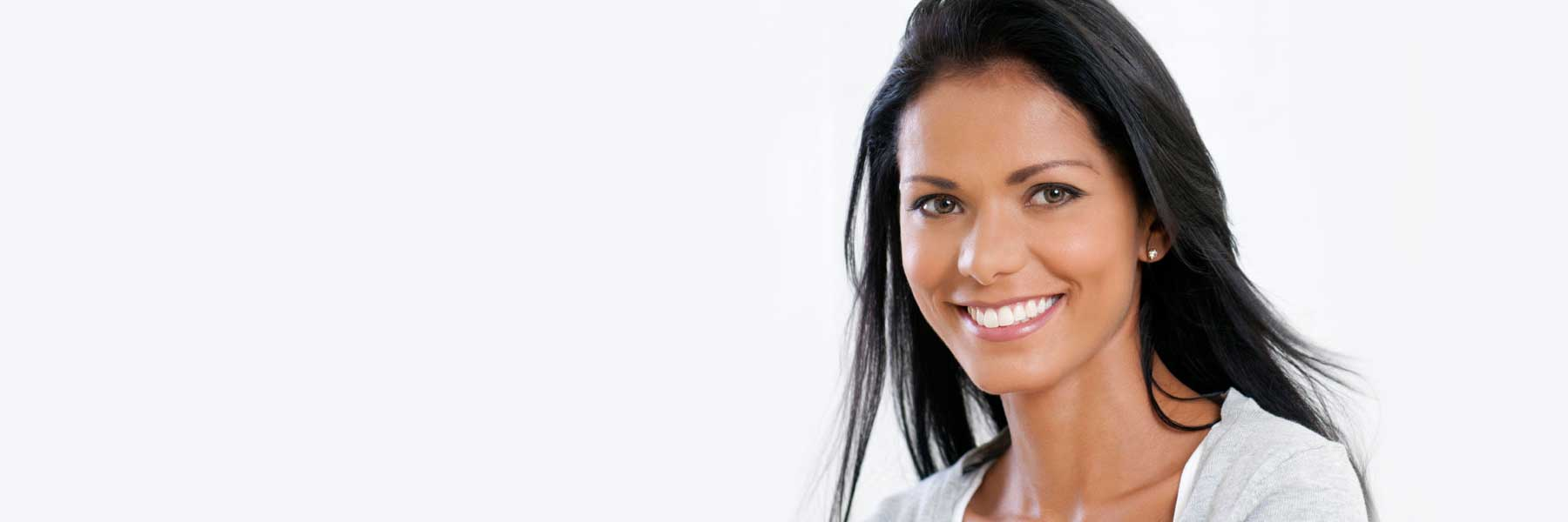 a man smiles infront of a white backdrop | Dentist in Bridgeton, MO