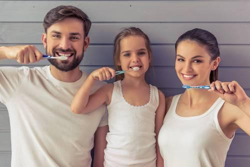 Family brushing their teeth together | Bridgeton Dentist Office