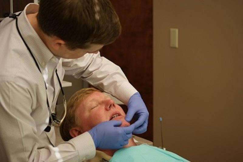 Dr. Burgdorf helps a patient | occlusal guards bridgeton mo
