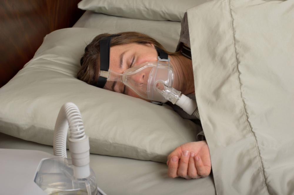 woman wearing sleeping appliance | Sleep Dentist Bridgeton MO
