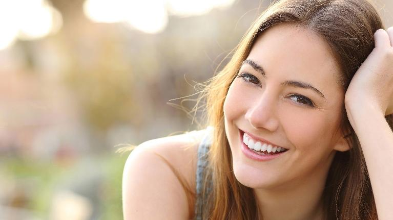 A woman lays down and smiles | Bridgeton MO Dentist