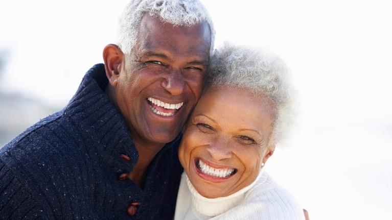 an older couple smiles outside | dentures Hazelwood mo