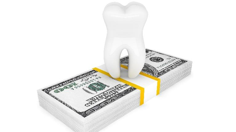 A tooth on top of cash | Bridgeton MO Dentist