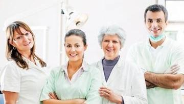 A group of medical professionals stands and smiles | Family Dentist in Bridgeton MO