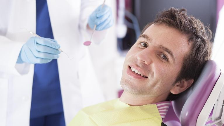 a man smiles in the dental chair | dentist bridgeton mo