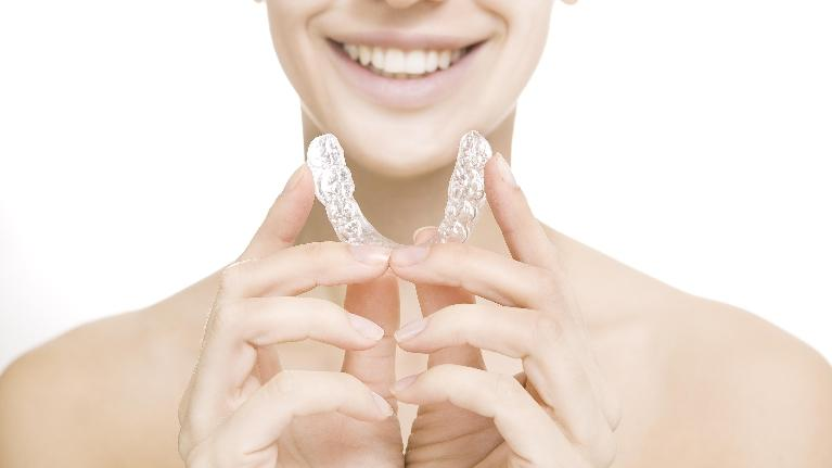 a woman holds a night guard | occlusal guards bridgeton mo