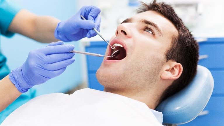 A man is examined in the dental chair | Oral Cancer Screening Bridgeton MO