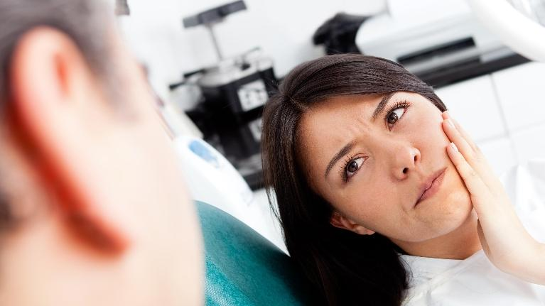 Picture of a patient seeing the dentist for a sore tooth | bridgeton mo root canals